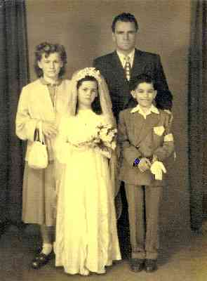 My mom -- Louisa Yurman at the time -- at her confirmation. Her cousin Lino is with her and she's joined by her Uncle Frank Carlovich and Aunt Yolanda Yurman. Circa 1953.
